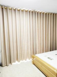 南宁五象新区碧水天和纯色窗帘案例